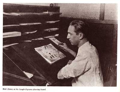 photograph of Walt Disney at his drawing board