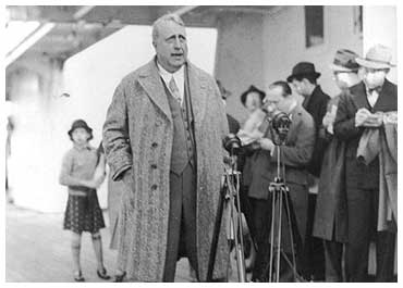 William Randolph Hearst speaks to his reporters