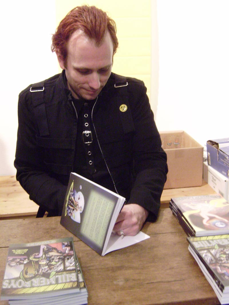 Yiri T. Kohl signing the Bijlmerboys Omnibus at Lambiek in February 2009
