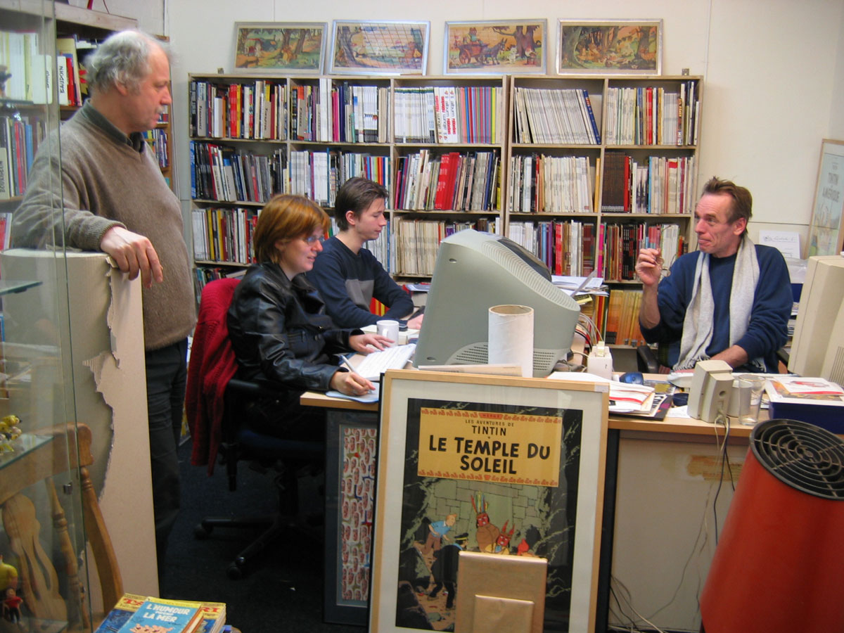 Lambiek.Net crew on a busy Friday in 2003 in the comics holodeck at Kerkstraat 119 in Amsterdam (photo by Rick Webbmaster)