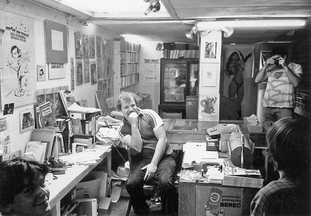 Kees Kousemaker at the old Lambiek comics shop store at Kerkstraat 104 in Amsterdam (around 1979)